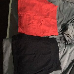 Two bodycon mini skirts: red and black. 2 for $5